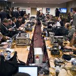 Journalists are at work in a press room